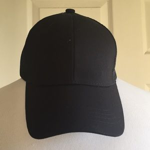 Black trucker hat with pony tail hole!